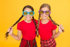 Party style. school prom party. red fashion girls. happy little girls in checkered skirt. stylish kids in school uniform royalty free stock photos