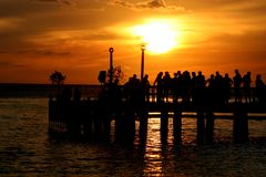 Party at Sunset. A group of people on a dock at sunset stock photos
