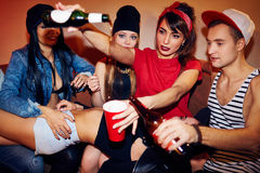 Party of swag teens. Young people having drinks in swag club Stock Photo