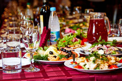 Party table with alcohol,food and drinks Stock Photography