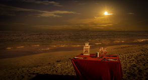 Party table on the beach. Sunset caribbean beach landscape and party table Royalty Free Stock Images