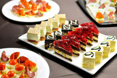 Party table with cakes and canapes Royalty Free Stock Photography