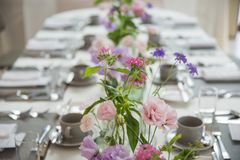 Party table decorated with beautiful flowers royalty free stock photos