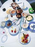 After the party. Table filled with half full platters, bowls and glasses Royalty Free Stock Images