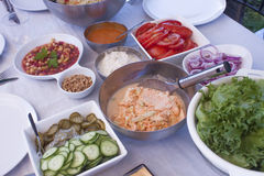 Party table full of salads Stock Images
