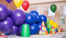 Party table with latex baloons in different colours royalty free stock photography
