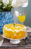 Party table with peach cheese cake Royalty Free Stock Photos