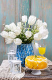 Party table with peach cheese cake Stock Image