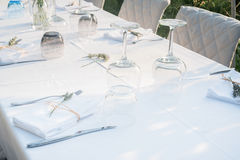 Party table set for a social event in the countryside Stock Photo