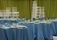 Party table setting. Getting ready for a party; table setting and chairs Stock Photography