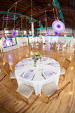 Party Tables in Gymnasium. Decorated party tables set up in a gymnasium with a wooden floor royalty free stock photos