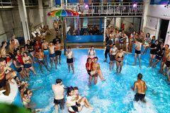 Party for teenagers AQUA MADFLOW at Russia, Kirov city, AquPark named Friendship on 19.08.2018. Kirov, Russia - August 19, 2018: Teenagers on party AQUA MADFLOW stock photos