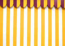 Party tent background. Pattern, with yellow and white stripes. Photo was taken in August 2014 Royalty Free Stock Photo