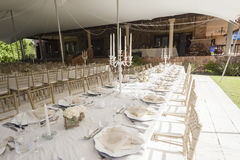 Party Tent Chairs Tables Home. Decor Dining chairs tables outdoors tent celebration party outdoors at private home Royalty Free Stock Photos