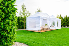 Party tent - white garden party or wedding entertainment tent in Royalty Free Stock Photography
