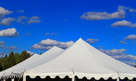 Party Tent. White wedding, Party or event Tent on Blue Sky Royalty Free Stock Image