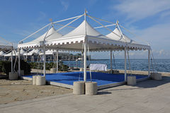 Party tents. White canopy tents for exibition event and party near the sea royalty free stock images