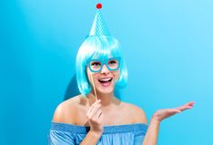 Party theme with a woman in blue wig. Party theme with a woman in a bright blue wig Stock Images