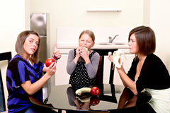 Party. Three cheerful girls. Stock Image