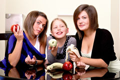 Party. Three cheerful girls. Royalty Free Stock Photos