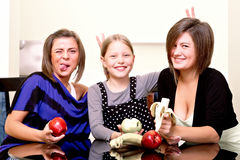 Party. Three cheerful girls. Royalty Free Stock Images