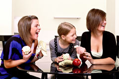 Party. Three cheerful girls. Stock Photo