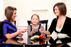 Party. Three cheerful girls. Stock Photography