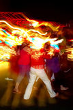 Party time. People dancing with lights illuminating their heads Royalty Free Stock Photo