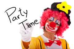 Party Time. Funny clown writing Party Time on the whiteboard royalty free stock photo