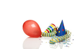 Party time. Party decoration -  balloon, streamer, confetti, party hats isolated on white, copy space top and left Royalty Free Stock Photography