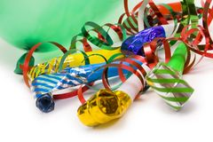 Party time. Party blowers, balloon and paper streamers Stock Photo
