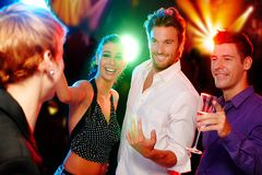 Party time. Young companionship having fun in discotheque Royalty Free Stock Image