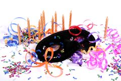 Party Time. Party items including a mask, candles and ribbons for celebrating new year Stock Photography