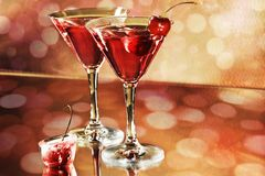 Party time. Red cocktail in a martini glasses on holiday background stock photos