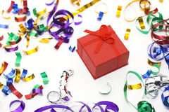 Party time. Confetti on white background with gift box Royalty Free Stock Images