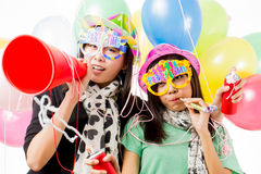 Party time. Asian women having a party shooting in studio royalty free stock photos