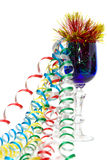 Party time - Blue glass with colorful ribbons Stock Photo