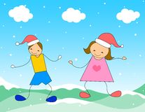 Party Time - Christmas. Two kids dancing on snow wearing red Christmas / Santa hats Stock Images