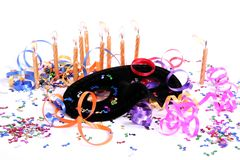 Party Time Decorations. Party items including a mask, candles and ribbons for celebrating new year Royalty Free Stock Image