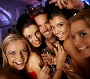 Party time with happy people. Young attractive people having party fun, drinking, laughing Royalty Free Stock Photos