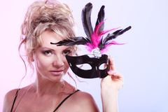 Woman middle aged holds carnival mask. stock photography