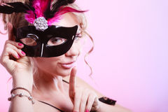 Woman middle aged holds carnival mask. Royalty Free Stock Image