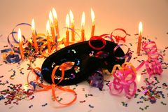Party Time Items. Party items including a mask, candles and ribbons for celebrating new year Stock Image