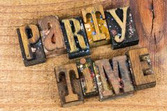 Party time fun sign letterpress message. Party time message letterpress wood block letters words fun and games people sign retro encouragement stock image
