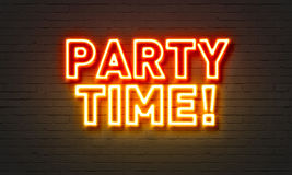 Party time neon sign on brick wall background. stock images