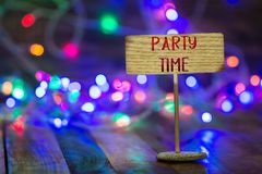 Party time on small sign board stock images