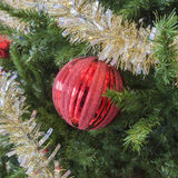 Party tinsel and red glittery ornament on festive holiday Christ Stock Image