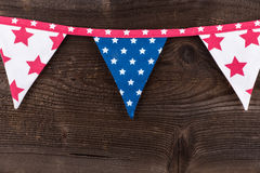 Party triangle bunting flags hanging on the rope. Royalty Free Stock Image