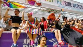 Party truck with drag queens driving by at the antwerp gay pride parade, Flemish LGBT festival, 6 august, 2019, antwerpen, Belgium. A party truck with drag stock video