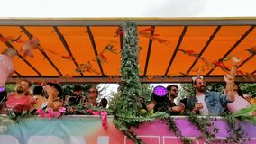 Party truck driving by full with people partying during the antwerp gay pride parade, Flemish LGBT festival, 6 August, 2019,